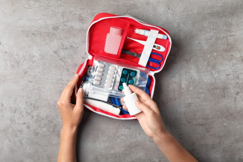 Woman with First Aid Kit