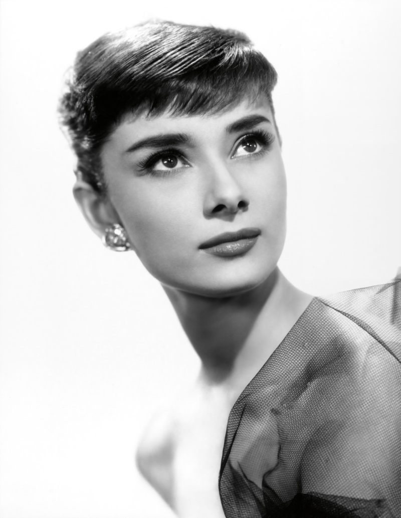 Audrey Hepburn wears a pixie haircut in the 1950s for Sabrina promo shoot.  Photo Credit: Paramount Pictures / Album / Alamy Stock Photo