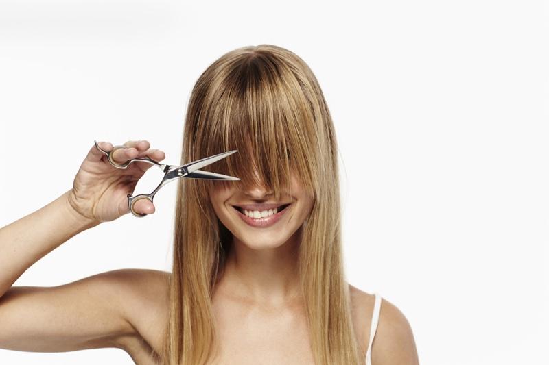 Blonde Woman Cutting Bangs Scissors