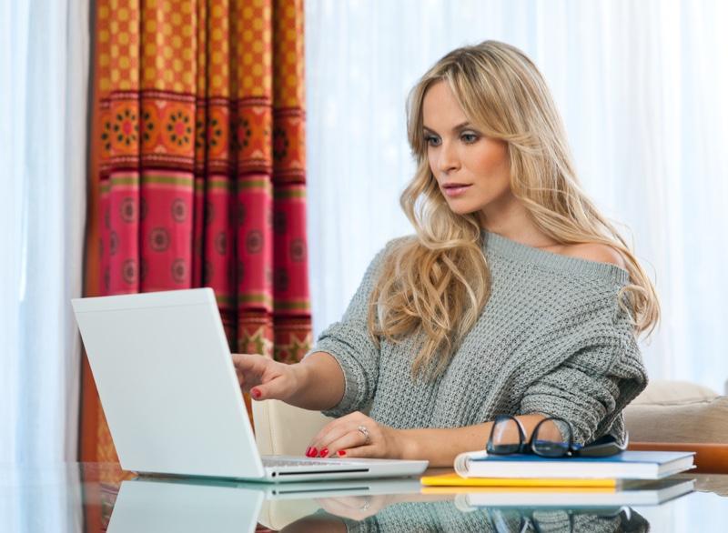 Blonde Woman Using Laptop Grey Sweater
