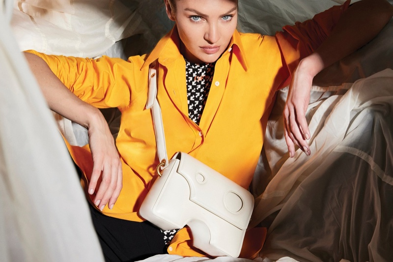 Model Candice Swanepoel fronts Off-White Burrow bag fall-winter 2021 campaign.