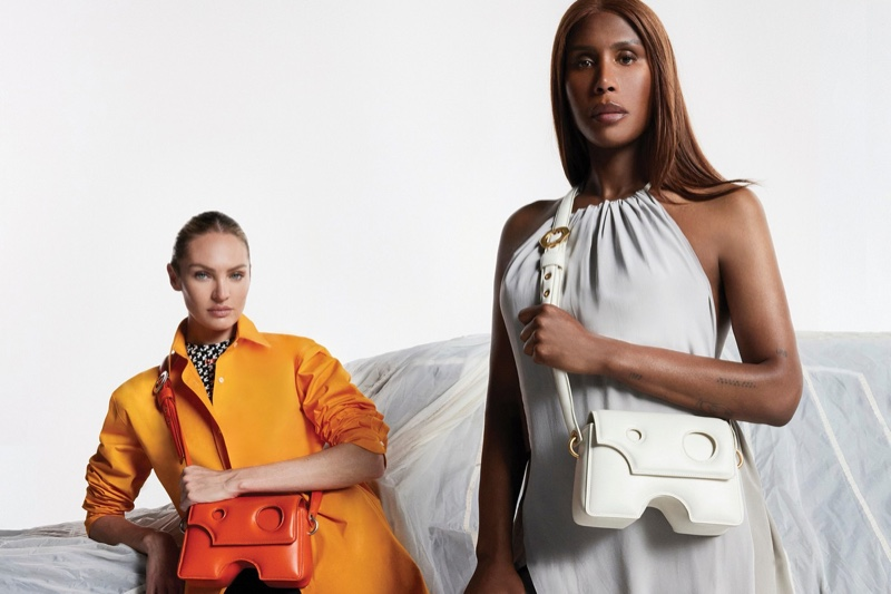 Candice Swanepoel and Honey Dijon pose with the Off-White Burrow bag.