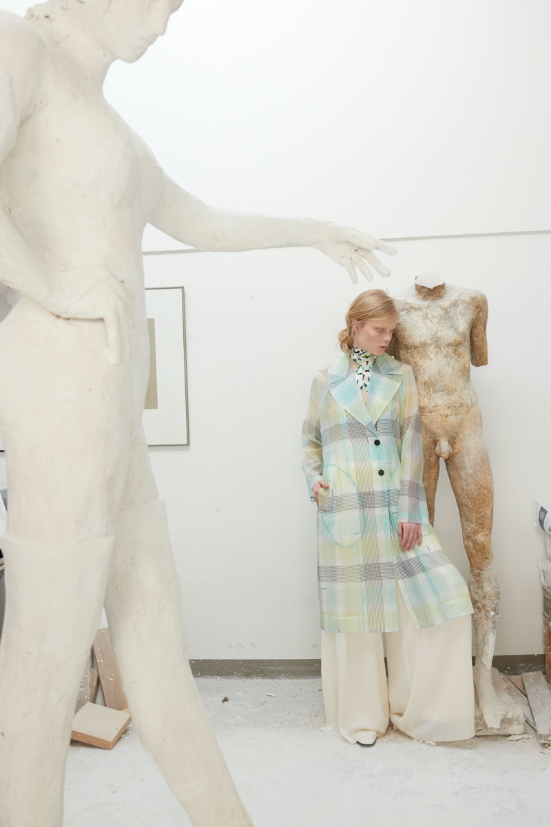 Emily Liptow Poses With Works of Art for Quality Magazine