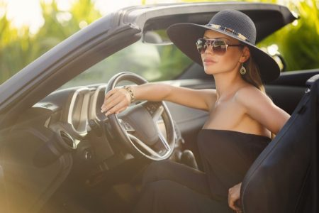 Glamour Woman Driving Convertible Car Hat Sunglasses