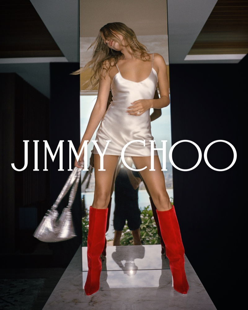 Model Hailey Bieber wears red boots in Jimmy Choo fall 2021 campaign.