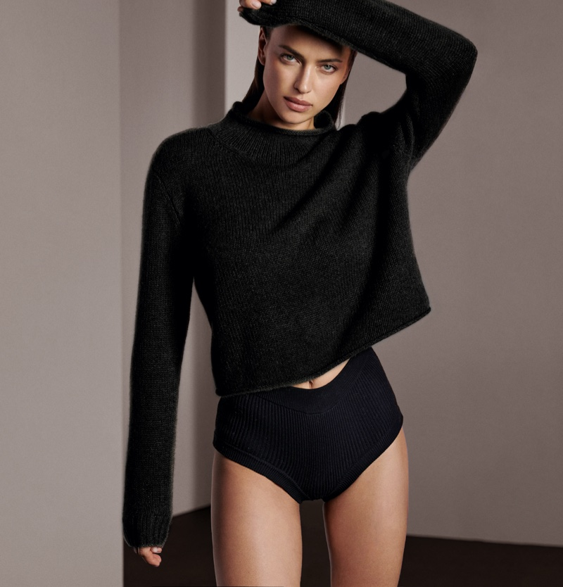 Dressed in black, Irina Shayk fronts NAKEDCASHMERE fall 2021 campaign.