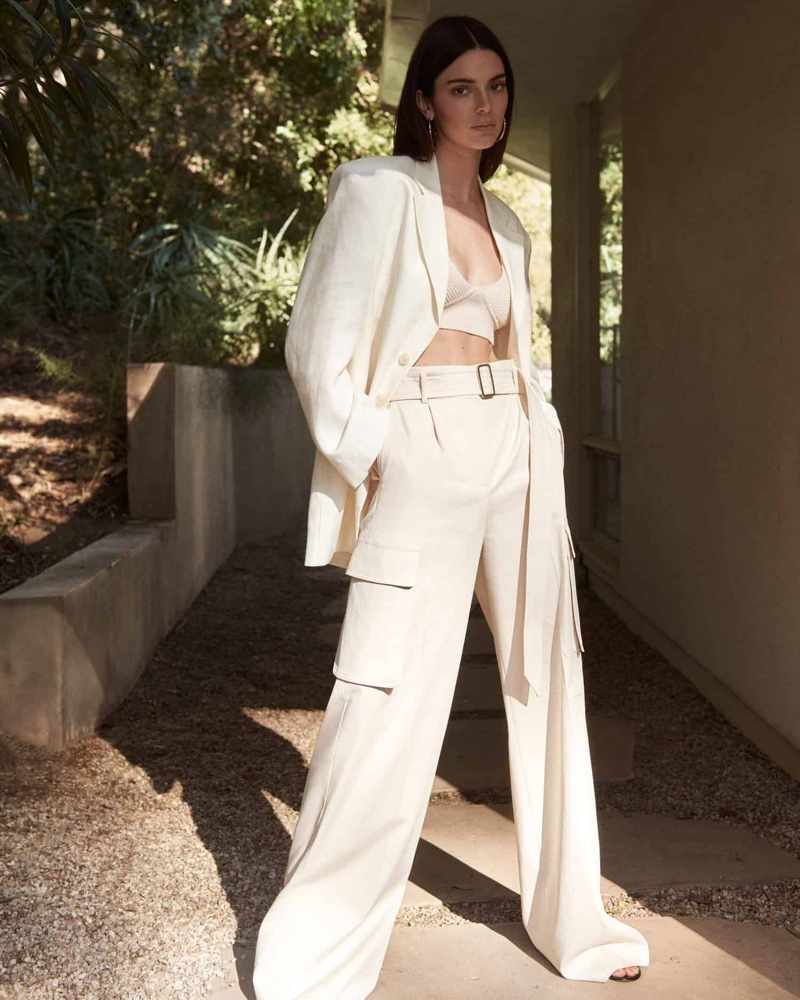 Dressed in a white outfit, Kendall Jenner wears a chic look for FWRD shoot.