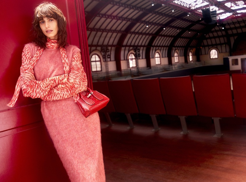 Dressed in red, Mica Arganaraz fronts Longchamp fall-winter 2021 campaign.