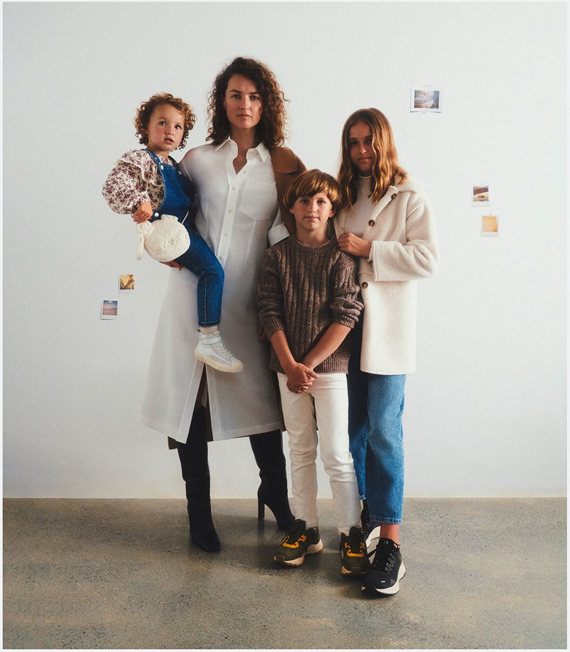 Caroline Barton poses with children Bronte, Carter, and Darcy for Mango This is Family fall-winter 2021 campaign.