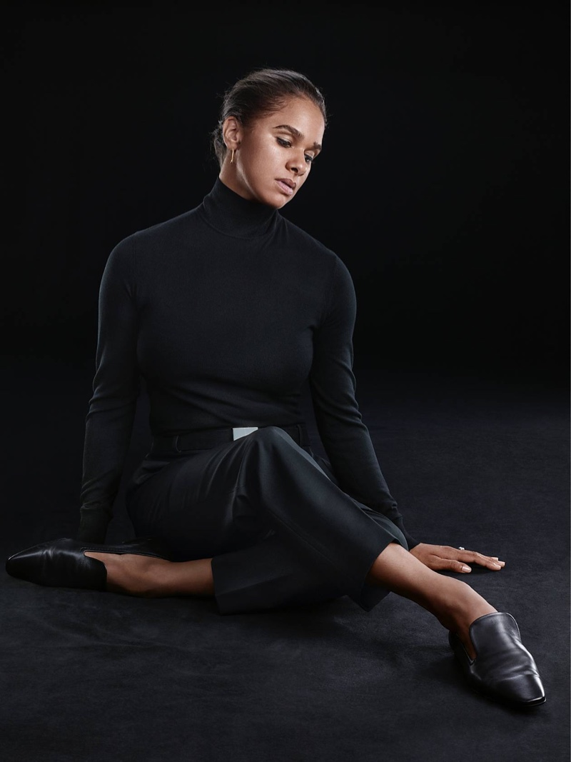 Misty Copeland wears Theory turtleneck sweater and waist-tab pant in crepe.
