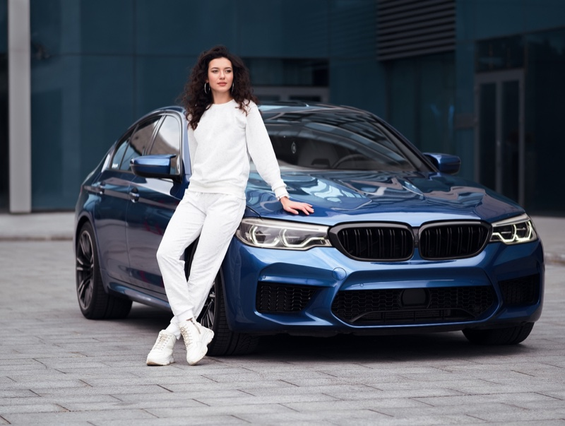 Model Posing Next Blue Car Casual Sneaker Outfit