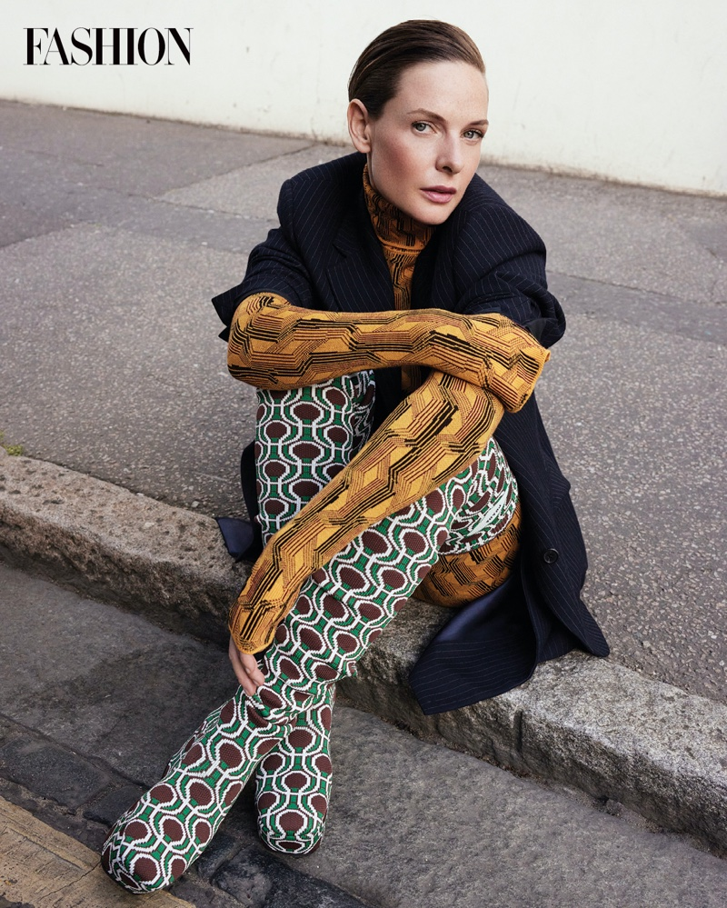Dune actress Rebecca Ferguson poses in Prada jacket, bodysuit, skirt, and boots. Photo: Royal Gilbert / FASHION