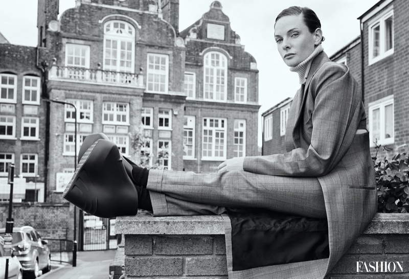 Photographed in black and white, Rebecca Ferguson poses in Givenchy look with Vetements sweater. Photo: Royal Gilbert / FASHION