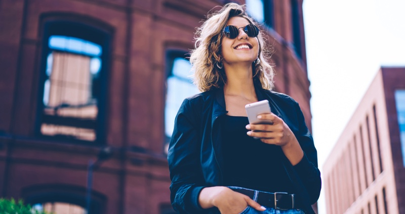 Smiling Woman Phone Outside Urban Area