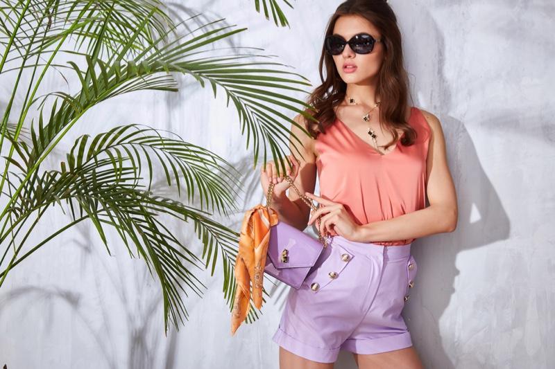 Stylish Woman Purple Shorts Pastel Look
