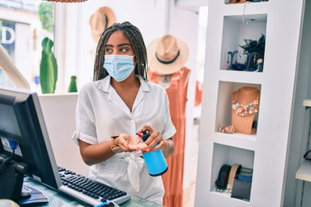 Woman Wearing Mask Working at Retail Store