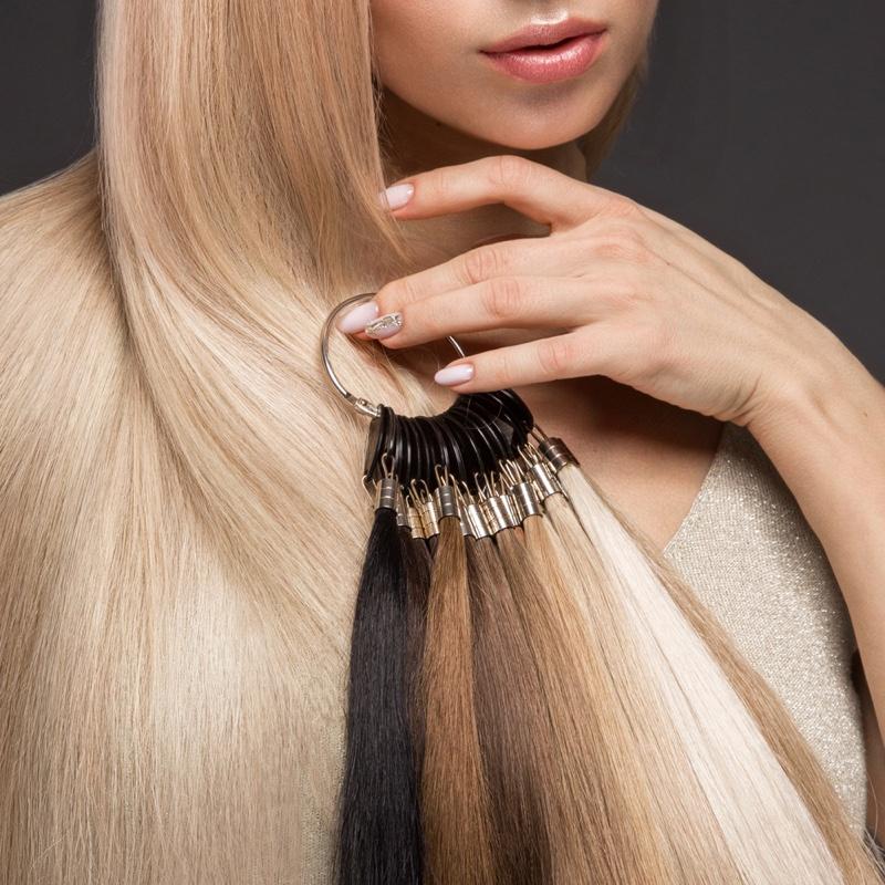 Blonde Model Posing Hair Extension Selection