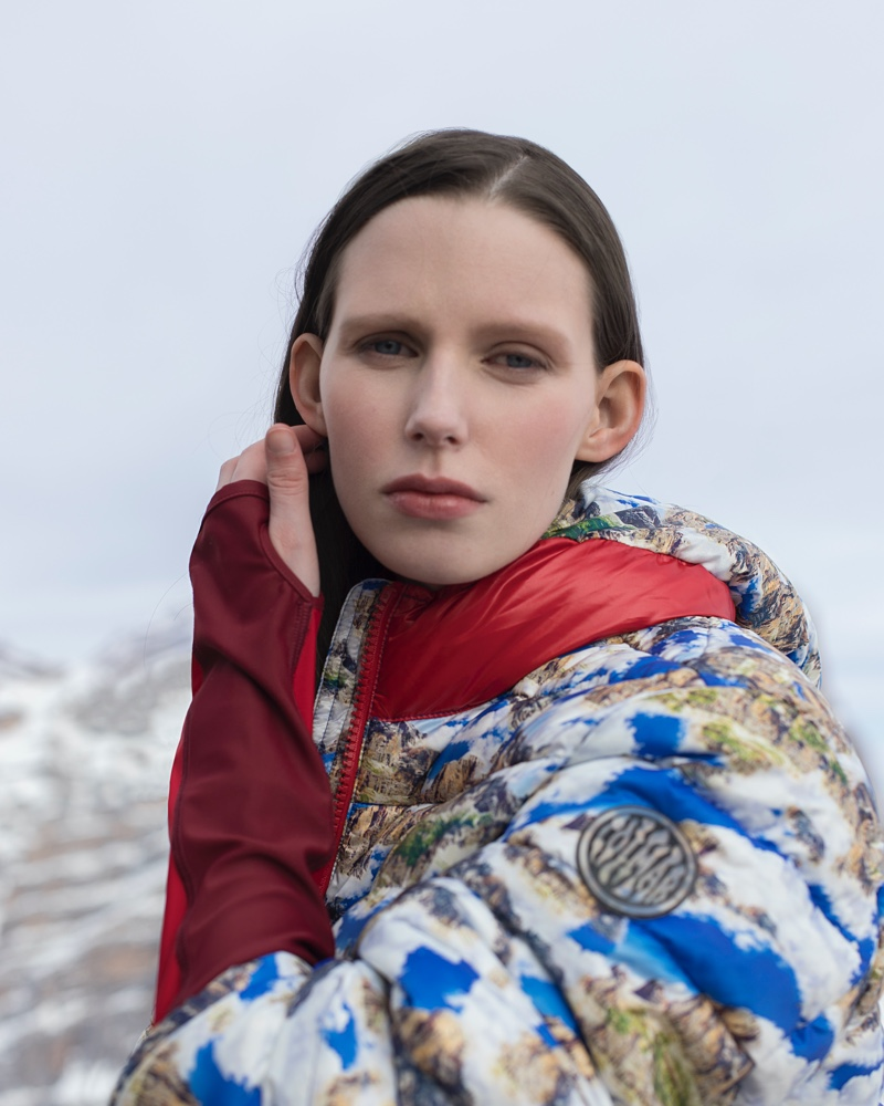 Making a graphic statement, Lina Simonsen wears a Colmar A.G.E. by Morteza Vaseghi printed hooded jacket.