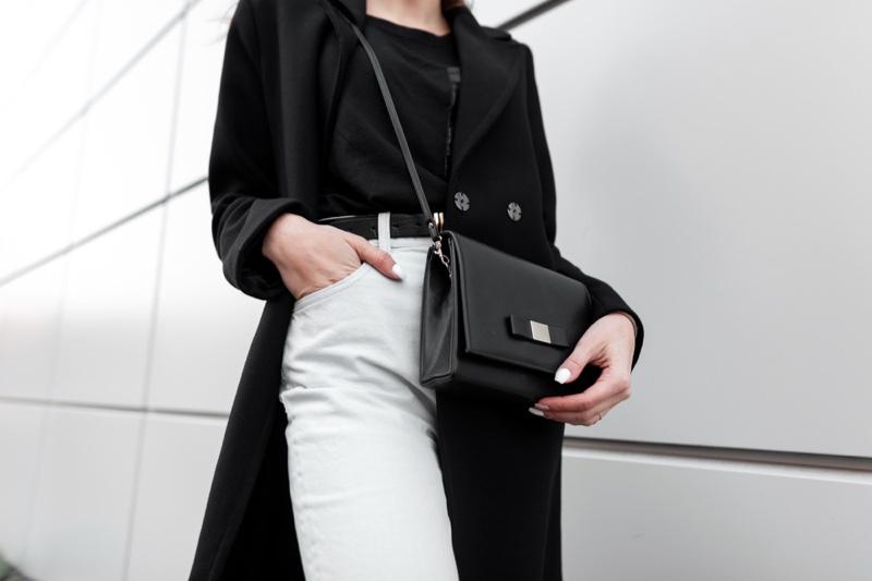 Cropped Woman Black Coat Shirt White Jeans Bag