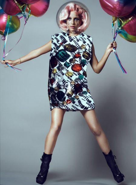 Posing with balloons, Emma Chamberlain wears Louis Vuitton x Fornasetti jacket. Photo: Domen & Van de Velde / Courtesy of V Magazine