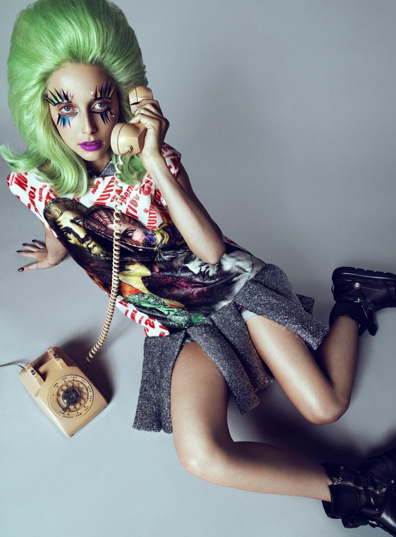 Answering the phone, Emma Chamberlain wears Louis Vuitton x  Fornasetti dress and boots. Photo: Domen & Van de Velde / Courtesy of V Magazine