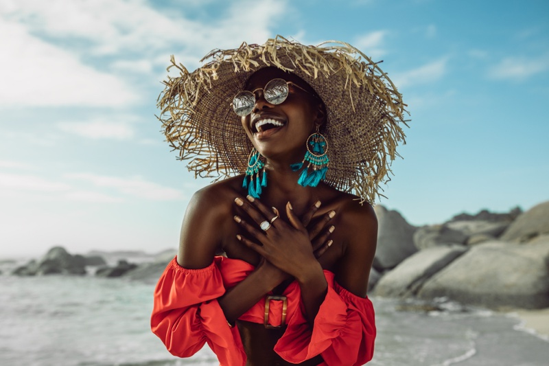 Happy Black Woman Beach Straw Hat Turquoise Earrings Red Top