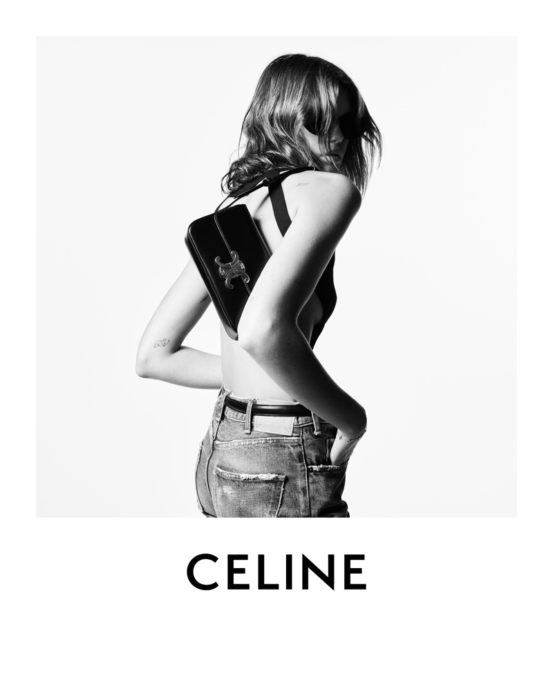 Model Kaia Gerber poses with Celine Triomphe shoulder bag for the brand's winter 2021 campaign.