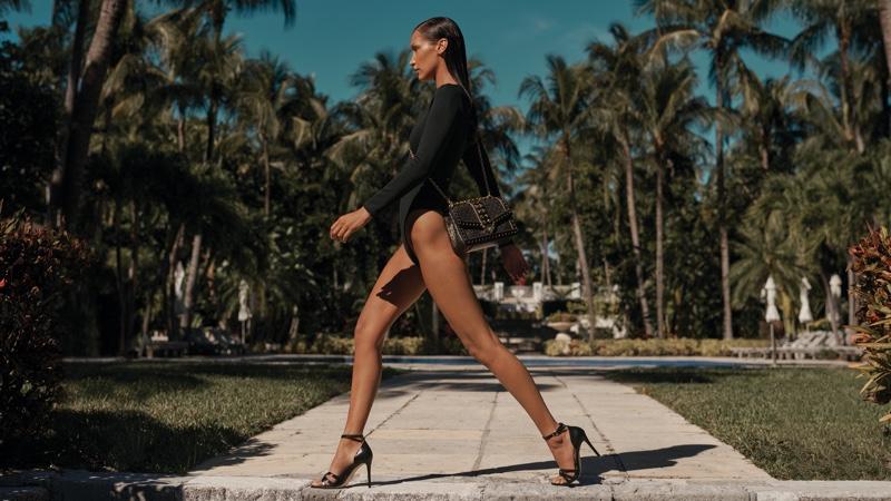 Bella Hadid flaunts her legs in Michael Michael Kors x 007 collaboration campaign.