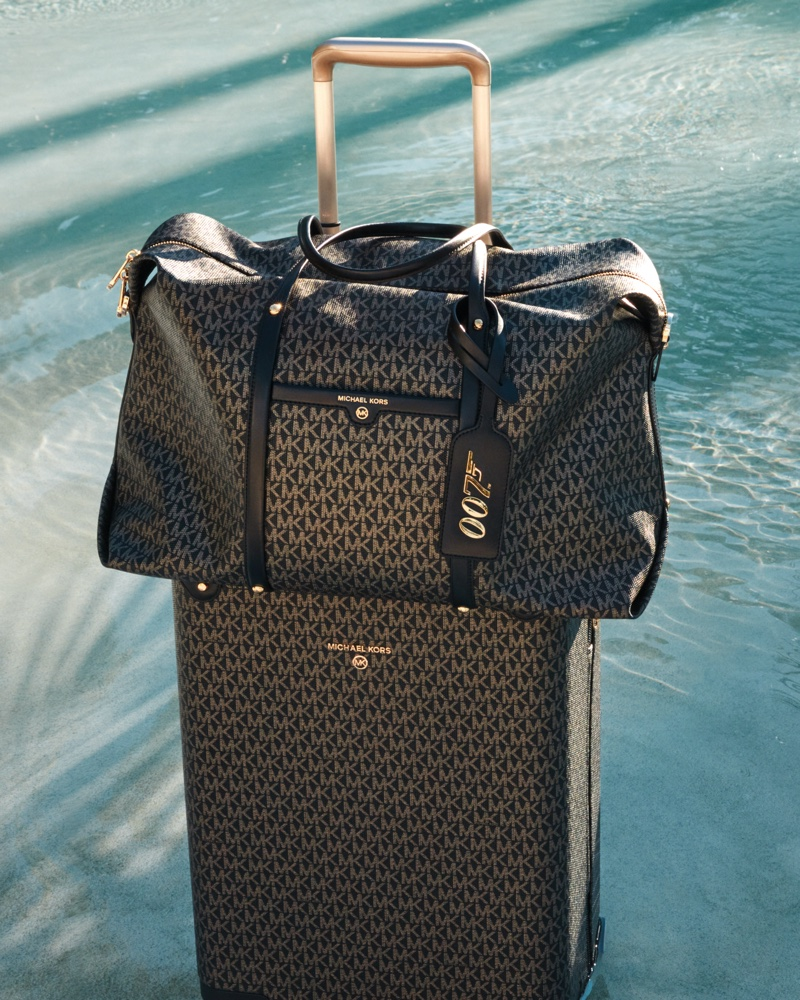 Beck Weekender bag and luggage from Michael Michael Kors x 007 collaboration.