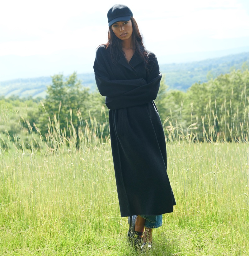 Posing outdoors, Jasmine Tookes appears in NAKEDCASHMERE NAKED in October 2021 campaign.