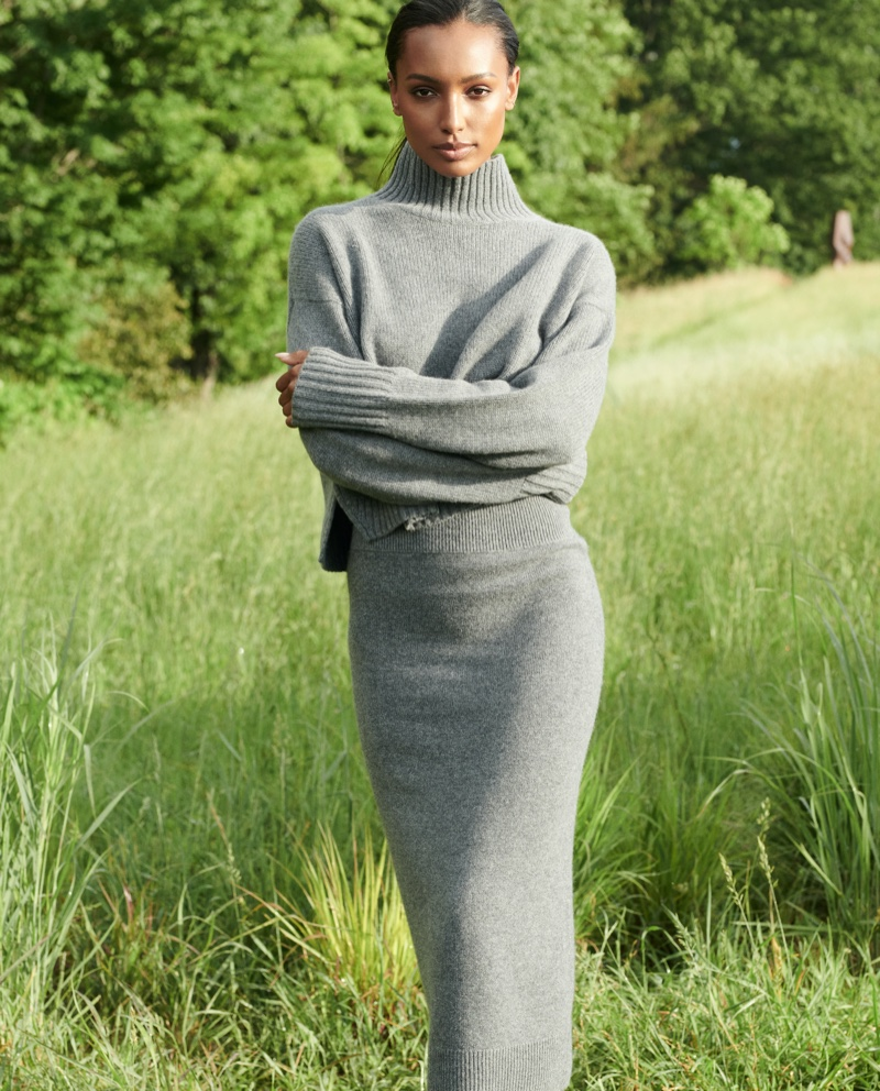 Jasmine Tookes poses in a grey knit set for NAKEDCASHMERE NAKED in October 2021 campaign.