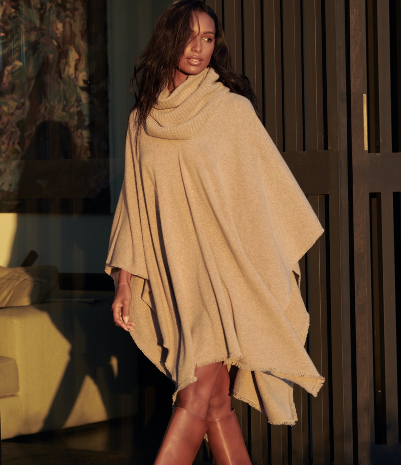 Wearing a poncho, Jasmine Tookes fronts NAKEDCASHMERE NAKED in October 2021 campaign.