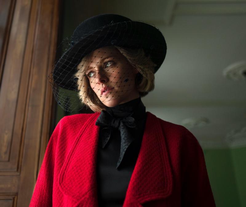 Wearing a black veiled hat and red tweed coat, Kristen Stewart plays Princess Diana in SPENCER. | Photo Credit: Pablo Larrín