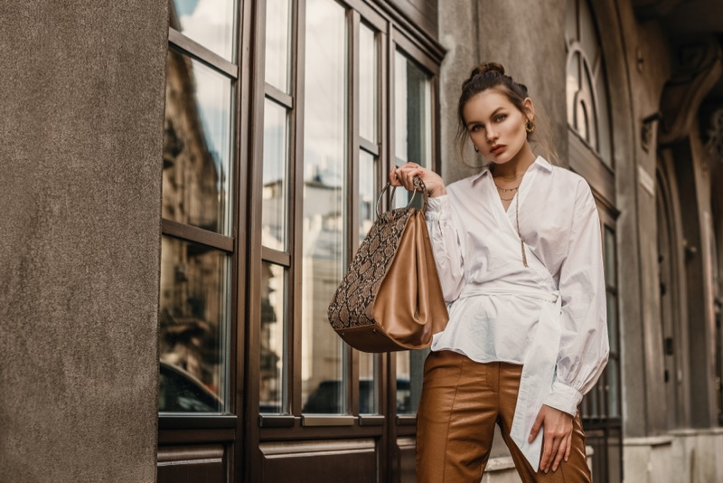 White Long Shirt Tied Brown Pants Python Print Bag Outfit