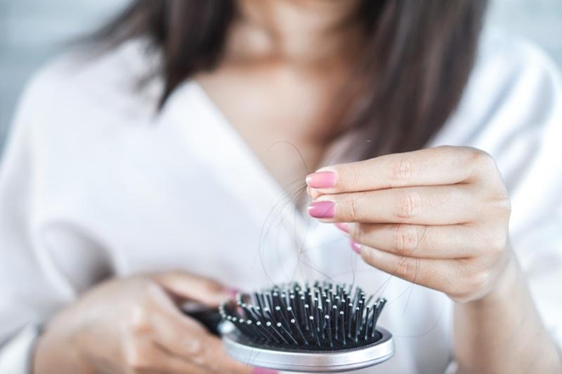 Woman Holding Hair Brush