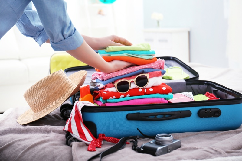 Woman Packing Luggage Suitcase