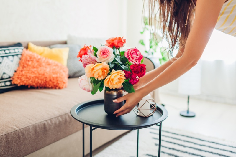Woman Placing Flowers Home