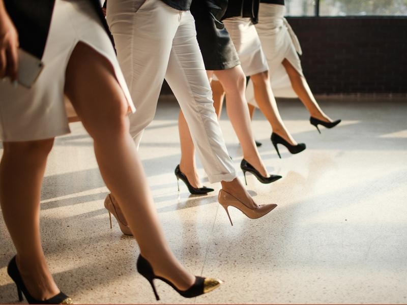 Woman Walking Heels Work Concept