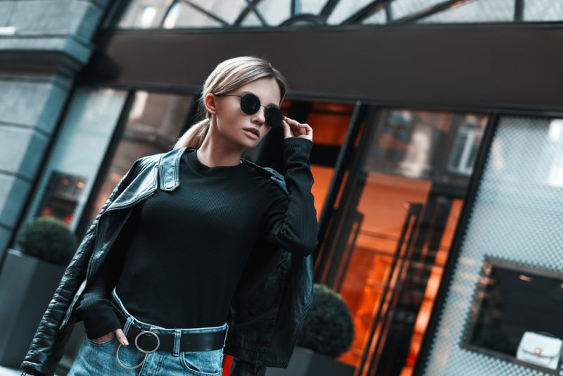 Woman Wearing Leather Jacket and Tucked In Top