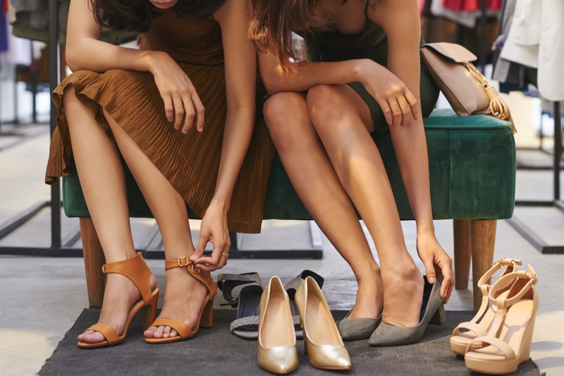 Women Trying On Shoes Heels Sandals