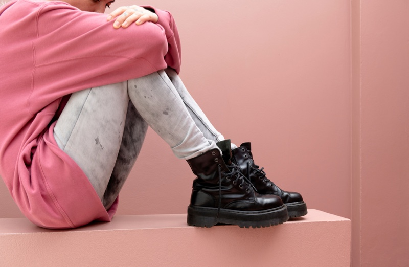 Young Woman Distressed Jeans Black Combat Boots